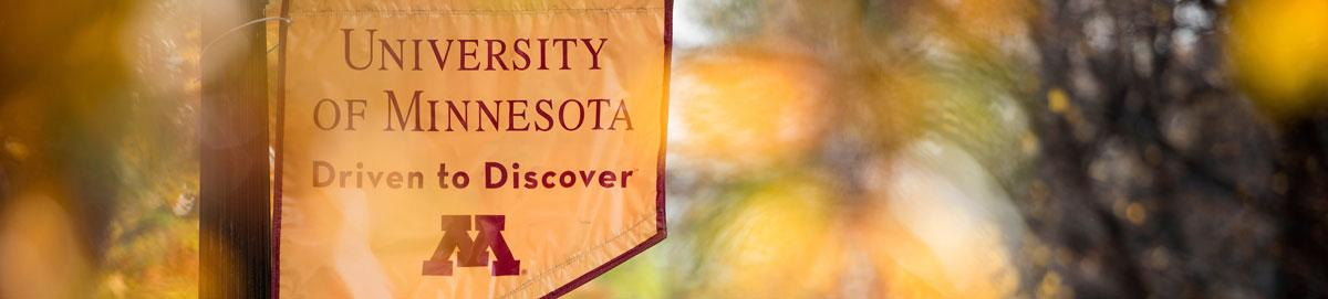 Gold banner with text that says University of Minnesota Driven to Discover